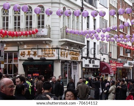 LONDON- FEB 6: People celebrate the annual Chinese new year in Chinatown, London, on Feb 6, 2011. Thousands of people visited the event.