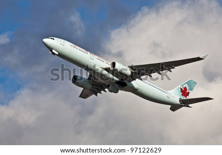 LONDON - FEBRUARY 19: Canadian Airlines Airbus A330 leaves Heathrow on route to Canada on February 19, 2012 at London. As of Nov 2011, 828 A330's units had been built. Cost per unit averages US$205 Mn