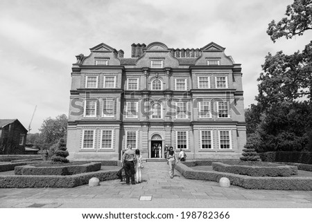 LONDON, GREAT BRITAIN - 5th of May 2014: Kew Palace,  brick mansion at Kew Gardens, England on 5th of May 2014 in LONDON, GREAT BRITAIN (black and white)