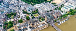 London. Helicopter view of Westminster Palace and Bridge on a beautiful summer day.
