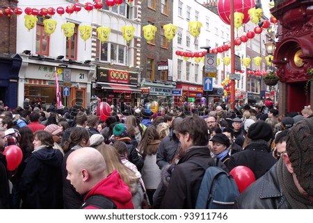 LONDON- JAN 29: Crowds of 1000s celebrate the year of the dragon chinese new year in trafalgar square and chinatown. London, jan 29, 2012.