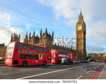 LONDON - JAN 21: London Buses with Big Ben on January 21, 2012 in London, England. The London Bus service is one of the largest urban bus networks in the world with 8,000 buses covering 700 routes.