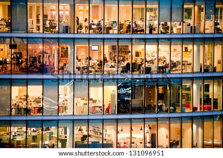 LONDON - JAN 31: people work in an office building in London on January 31, 2013. Full-time employees in the UK work longer hours than the EU average, according to the Office for National Statistics.