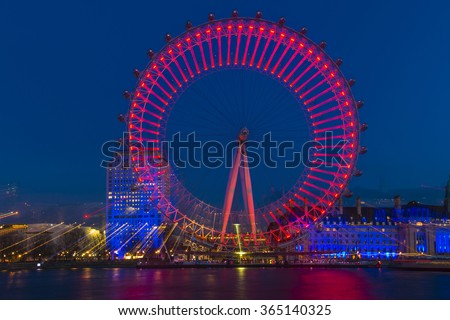 LONDON - JANUARY 16, 2016: Night shot of the London Eye with zoomed effect. The London Eye is a giant Ferris wheel on the South Bank of the River Thames and offers a great viewing point over London
