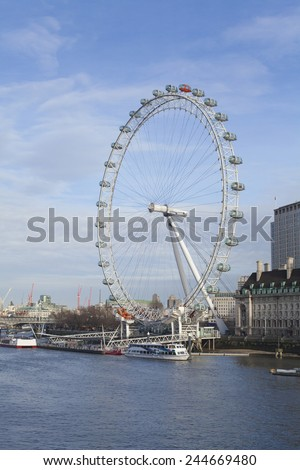 LONDON - JANUARY 9, 2015: View of the London Eye in daytime. London Eye (135 m tall, diameter of 120 m) - a famous tourist attraction over river Thames in the capital city London