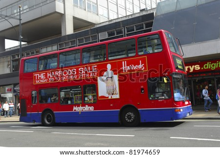 LONDON -JULY 16 : A Double decker red bus is shown along Oxford Street on July 16, 2006 in London. According to Bloomberg, there are approximately 548 shops here and it is Europe's busiest shopping street.