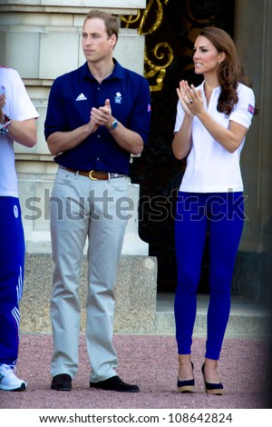 LONDON - JULY 26:  Kate Middleton, Prince William and Prince Harry are seen outside Buckingham Palace waving to crowds, July 26, 2012 in London, Uk