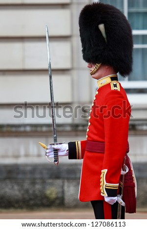 LONDON - JULY 4: Queen's Guard soldier during Changing the Guard ceremony on July 4, 2012 in London. Changing the Guard in front of Buckingham Palace takes place at 11.30 am daily from May to July. - stock photo