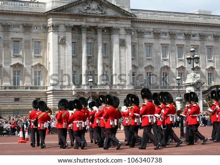 LONDON - JULY 15, 2009:   The colorful changing of the guard ceremony at Buckingham Palace on July 15, 2009 in London, which is one of England's most popular visitor attractions.