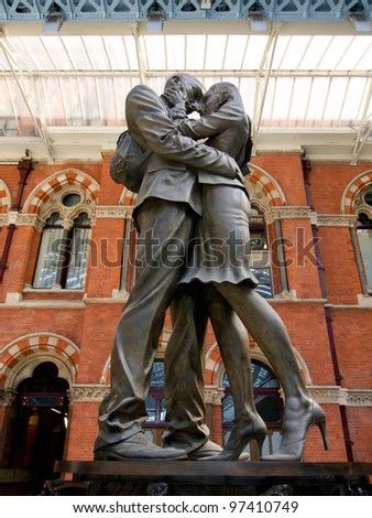 LONDON - JULY 24. The Embracing Couple by Paul Day at 'the Meeting Place' greets passengers in preparation for London Olympic 2012 at St Pancras International Railway Station. July 24, 2011.