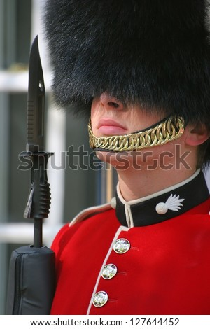 LONDON - JULY 19: The Queen's Guard is the name given to contingents of infantry and cavalry soldiers charged with guarding the official royal residences in London. London, UK, July 19, 2012.