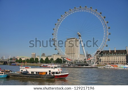 LONDON - JULY 26, 2012: View of The London Eye on July 26, 2012 in London, England. A famous tourist attraction over river Thames in the capital city London. July 26, 2012.