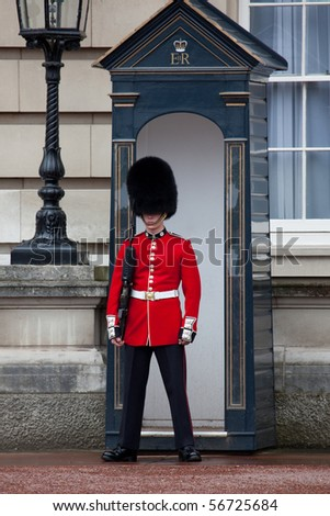 LONDON - JUN 11: Sentry of the Grenadier Guards posted outside of Buckingham Palace on June 11, 2010 in London, UK. - stock photo