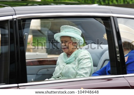 LONDON  JUNE 5 -  Britains Queen Elizabeth II drives in motorcade with The Lady Farnham, on her way to Westminster during the Queens 60TH Diamond Jubilee celebrations on June 5, 2012 in London.