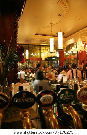 LONDON JUNE 3 Interior of pub for drinking and socializing focal point of the community on June 3 2006 London UK Pub business now about 53 500 pubs in the UK has been declining every year