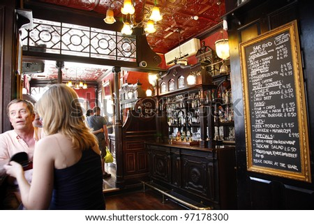 LONDON - JUNE 26: Interior of pub, for drinking and socializing, focal point of the community, on June 26, 2011, London, UK. Pub business, now about 53,500 pubs in UK, has been declining every year