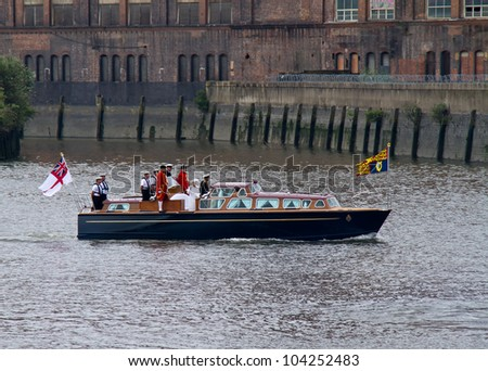 LONDON - JUNE 3: Queen Elizabeth II and Prince Philip as they journey on a motor launch at the start of the Diamond Jubilee Royal Pageant on the River Thames on June 3, 2012 in London