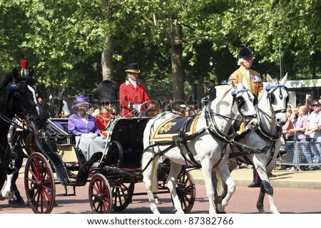 LONDON - JUNE 17: Queen Elizabeth II and Prince Philip seat on the Royal Coach at Queen's Birthday Parade on June 17, 2006 in London, England.