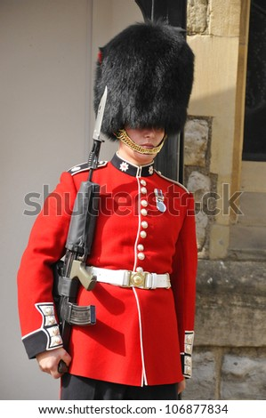 LONDON - JUNE 02:Queen's Guard - Tower of London on June 02 2012. The Queen's Guard is the contingents of infantry and cavalry soldiers charged with guarding the official royal residences.