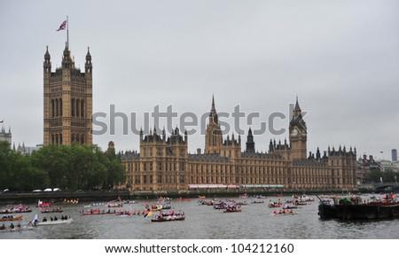 LONDON - JUNE 3rd 2012: Flotilla of pbats outside Parliament during Queen Elizabeth Diamond Jubilee River Pageant on June 3rd 2012 in London