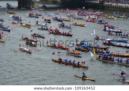 LONDON - JUNE 3: Unidentified boats sail down the River Thames during Diamond Jubilee Pageant celebration to mark the Queens Diamond Jubilee in London, England on June 3, 2012.