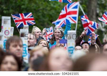 LONDON - JUNE 3: Unidentified people celebrate alongside the River Thames to witness Thames Diamond Jubilee Pageant on June 3, 2012 in London. #104261501