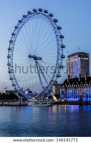 LONDON - JUNE 3: View of the London Eye at night, on June 3, 2013 in London, England. London Eye - a famous tourist attraction over river Thames in the capital city London.
