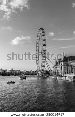 LONDON - JUNE 2, 2013: View of the London Eye. London Eye (135 m tall, diameter of 120 m) - a famous tourist attraction over river Thames in the capital city London. Black and white.