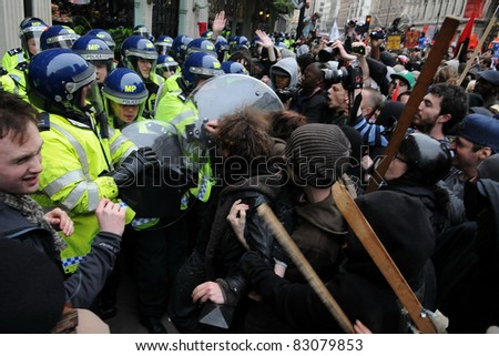 LONDON - MARCH 26: A breakaway group of protesters clash with police on Piccadilly during a large anti-cuts rally on March 26, 2011 in London, UK.