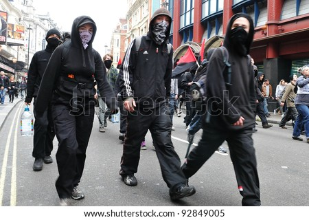LONDON - MARCH 26: A breakaway group protesters march through the streets of the British capital during a large austerity rally on March 26, 2011 in London, UK.