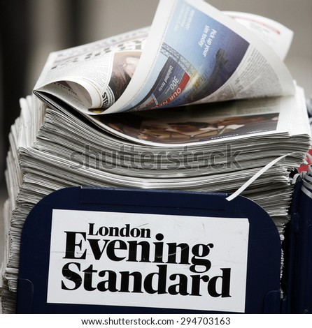 LONDON - MARCH 4: A pile of popular Evening Standard, free daily newspaper, evening tabloid paper, made available to afternoon commuters on March 4, 2013, London, UK.