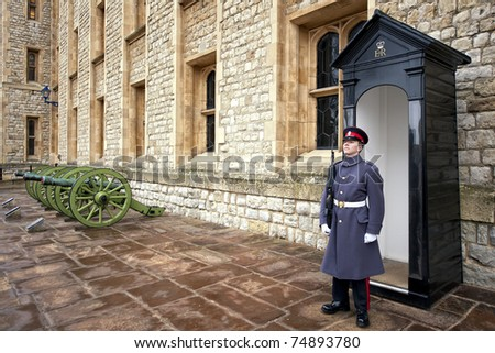 LONDON - MARCH 18: An unidentified  member of the England Military cadet stands guard at London Tower March 18, 2011 in London, England. They are in charged with guarding the official royal residences in London.
