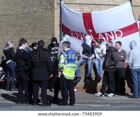 LONDON- MARCH 19: English defense league protesters demonstrate behind police lines, against London's latest mosque being built in Dagenham on March 19, 2011 in London.