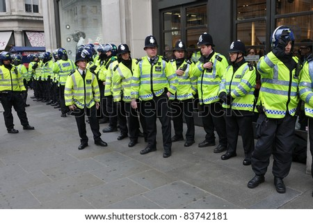 LONDON - MARCH 26: Police on standby in central London after violent clashes during a large anti-cuts rally on March 26, 2011 in London, UK.