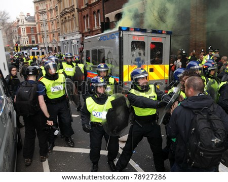 LONDON - MARCH 26: Riot police and protesters clash during a TUC organised anti-cuts rally March 26, 2011 in London, UK.