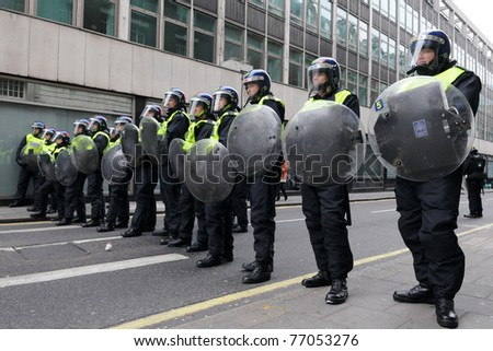 LONDON - MARCH 26: Riot police block a road entrance during a 250,000 strong anti public sector spending cuts rally organised by the TUC March 26, 2011 in London, UK.
