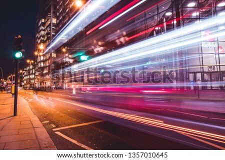 LONDON - MARCH 27, 2019: Traffic light trails on road outside NatWest bank building in City Of London #1357010645