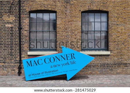 LONDON - MAY 25, 2015.. A three dimensional arrow promotes the Mac Conner exhibition at The House of Illustration , a public gallery at Granary Square, King's Cross, London, UK. #281475029