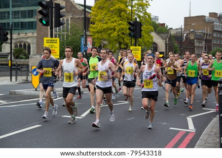LONDON - MAY 30: Athletes run in central London during a London 2012 Olympic marathon test event on May 30, 2011 in London, England.