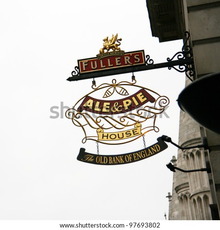LONDON - MAY 8: English pub sign, Public house, known as pub, is focal point of the community, on May 8, 2010, London, UK. Pub business, now about 53,500 pubs in UK, has been declining every year - stock photo