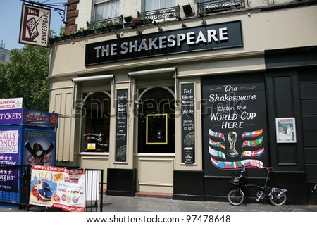LONDON - MAY 25: Exterior of pub, for drinking and socializing, focal point of the community, on May 25, 2010, London, UK. Pub business, now about 53,500 pubs in the UK, has been declining every year - stock photo