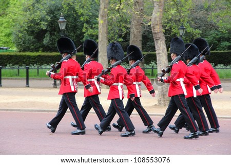 LONDON - MAY 16: Guards march for the Changing of the Guard in St. James's Park on May 16, 2012 in London. It is one of most recognized tourism attractions worldwide.