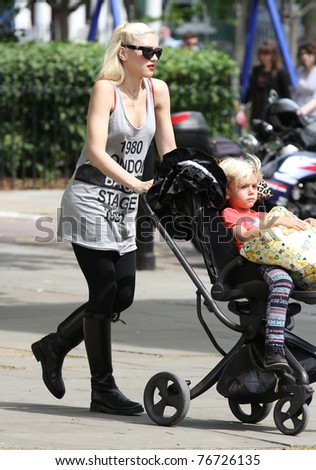 LONDON - MAY 6: Gwen Stefani walking in the street with her son Kingston Rossdale in his pram on May 6, 2011 in London.