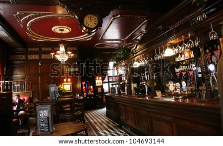 LONDON MAY 5 Interior of pub for drinking and socializing focal point of community on May 5 2012 London UK Pub business now about 53 500 pubs in the UK has been declining every year