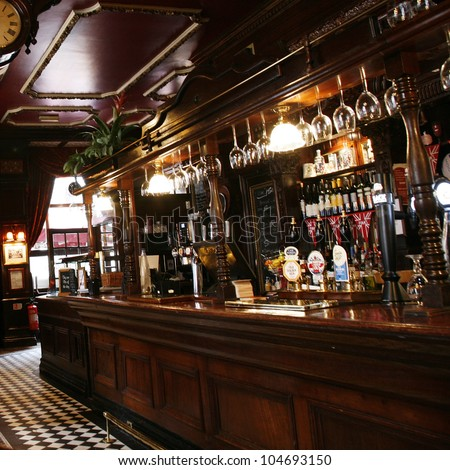 LONDON - MAY 5: Interior of pub, for drinking and socializing, focal point of community, on May 5, 2012, London, UK. Pub business, now about 53,500 pubs in the UK, has been declining every year