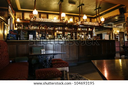 LONDON - MAY 16: Interior of pub, for drinking and socializing, focal point of community, on May 16, 2012, London, UK. Pub business, now about 53,500 pubs in the UK, has been declining every year