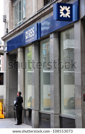 LONDON - MAY 15: Man exits RBS bank branch on May 15, 2012 in London. Royal Bank of Scotland was founded in 1727 and currently employs 141,000 staff (2011).