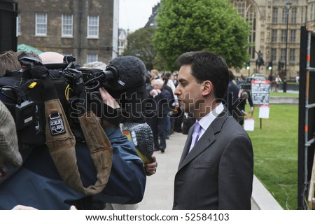 "LONDON - MAY 7 : Newly elected Labour Politician Edward ""Ed"" Samuel Miliband being interviewed by TV crew outside Parliament on May 7 2010 in Westminster, London during the UK General Election"