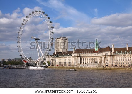 LONDON - MAY 14: People ride London Eye on May 14, 2012 in London. The Eye is the tallest ferris wheel in Europe.