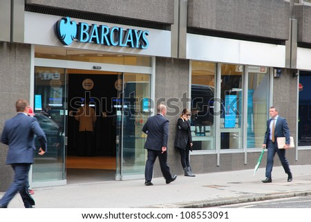 LONDON - MAY 15: People walk by Barclays bank branch on May 15, 2012 in London. Barclays was founded in 1690 and currently employs 146,100 staff (2011).